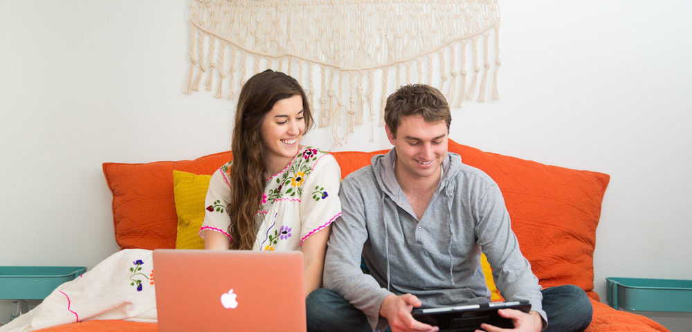 couple looking at finances on devices