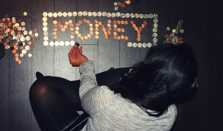 woman arranging coins